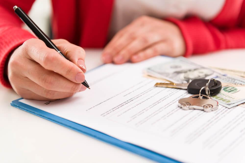 CloseUp Woman Auto Dealer Signing Rental